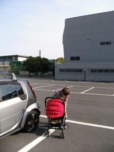 Katya fixing Mariya in a carriage